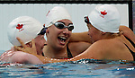Canadians swept the podium in women's 100 metre butterfly S13 action at the Paralympic Games in Beijing, Sunday, Sept., 7, 2008.  From left, Chelsey Gottell of Hamilton, Ont. took the bronze, silver medalist Kirby Cote of Winnipeg and Valerie Grand'maison of Montreal with gold.  Photo by Mike Ridewood/CPC