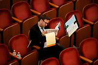 Jury member Sylvain Blassel looks through papers during Stage III at the 11th USA International Harp Competition at Indiana University in Bloomington, Indiana on Wednesday, July 10, 2019. (Photo by James Brosher)