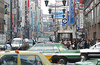 Traffic in Ginza district in Tokyo. Ginza is Tokyo's premiere and exclusive shopping district and home to many luxury brand names..Mar 2002