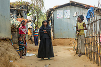 Bangladesh, Cox's Bazar. Kutupalong Rohingya Refugee Camp. The Rohingya, a Muslim ethnic group  denied citizenship in Burma/Myanmar have escaped persecution from Burmese militants in their country. There are up to 500,000 refugees and migrants living in makeshift camps in Cox's Bazar. People in the camp.