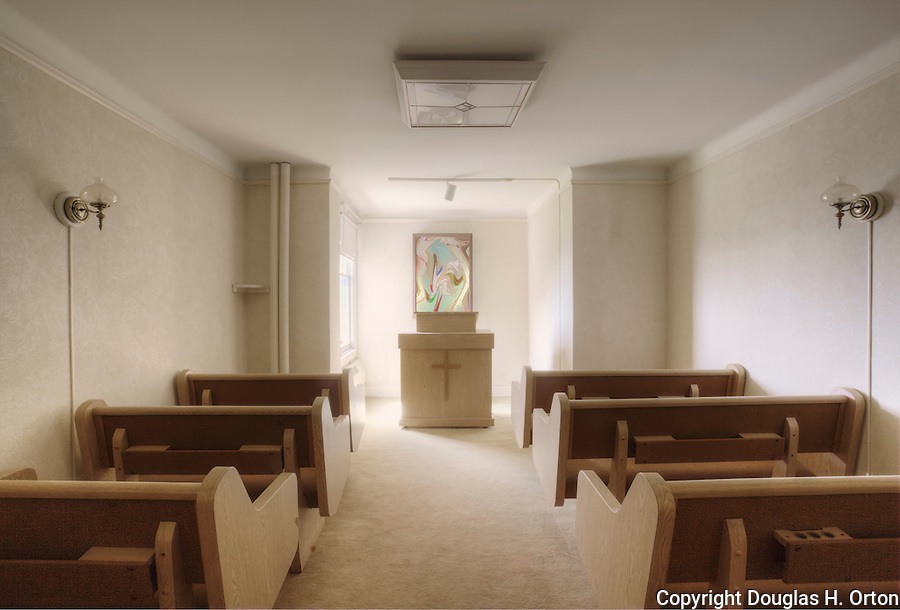 Small, intimate chaple with pews.  No longer in use.  Plastic, Stained glass artwork altered. Please conact douglasorton@comcast.net regarding licensing of this image.