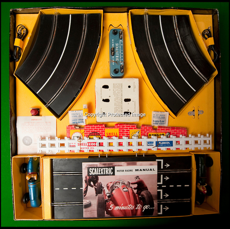 BNPS.co.uk (01202 558833)<br /> Pic: PhilYeomans/BNPS<br /> <br /> Original Scalextric.<br /> <br /> Blast from the past - 56 year old box of the very first Scalextric finally handed over to inventors daughters.<br /> <br /> The dying wish of Scalextric inventor Freddie Francis has been granted - after his daughters were gifted an original mint set that has been in storage for the past 50 years.<br /> <br /> Freddie and his widow Diane boxed up the original set shortly before he died in 1998 and Diana has waited till now before handing the valuable heirloom over.<br /> <br /> The previously unopened set has been preserved in a wooden box at the Francis family home until now.<br /> <br /> The historic set contains 1950's Ferrari and Maserati style racing car's that would have been driven by Fangio and Stirling Moss and even includes oil to keep the cars running and silicone for 'skid patches'.<br /> <br /> Although the set cost £5 in 1957, it's worth well over £1500 today.