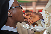 Nigeria. Abakaliki State. Uburu Amach. St. Patrick's Catholic Church. An Igbo catholic nun during the mass celebration for the 25th Priesthood Anniversary of Reverend Father Edward Inyanwachi. Sacramental bread, sometimes called altar bread, Communion bread, the Lamb or simply the host, is the bread used in the Christian ritual of the Eucharist (also referred to as the Lord's Supper or Holy Communion, among other names). Roman Catholic theology generally teaches that at the Words of Institution the bread is changed into the Body of Christ. 14.07.19 © 2019 Didier Ruef