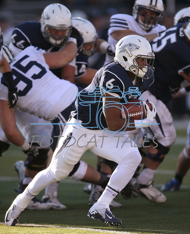 Nevada's Don Jackson (6) runs against BYU during the second half of an NCAA college football game in Reno, Nev., on Saturday, Nov. 30, 2013. BYU defeated Nevada 28-23. (AP Photo/Cathleen Allison)