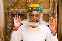 Jodhpur, Fort Mehrangarh, Rajasthan, India Bearded guard  in doorway of Fort Palace.