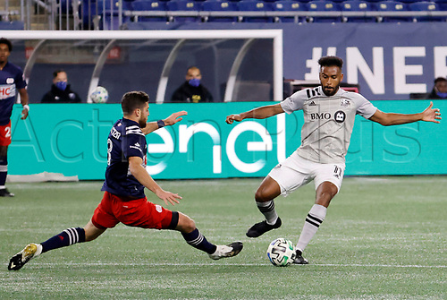 20th November 2020; Foxborough, MA, USA;  Montreal Impact forward Anthony Jackson-Hamel plays the ball as New England Revolution defender / midfielder Matt Polster (8) slides in during the MLS Cup Play-In game between the New England Revolution and the Montreal Impact
