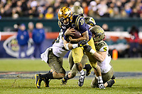 Philadelphia, PA - December 14, 2019:    Navy Midshipmen quarterback Malcolm Perry (10) gets tackled during the 120th game between Army vs Navy at Lincoln Financial Field in Philadelphia, PA. (Photo by Elliott Brown/Media Images International)