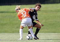 BOYDS, MARYLAND - July 22, 2012:  Molly Menchel (14) of DC United Women tackles Brooke Mulloy (12) of the Charlotte Lady Eagles during the W League Eastern Conference Championship match at Maryland Soccerplex, in Boyds, Maryland on July 22. DC United Women won 3-0.