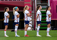 KASHIMA, JAPAN - AUGUST 2: Lindsey Horan #9 of the USWNT stands for the national anthem during a game between Canada and USWNT at Kashima Soccer Stadium on August 2, 2021 in Kashima, Japan.