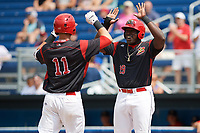 Batavia Muckdogs Lazaro Alonso (19) congratulates Tyler Curtis (11) after hitting his first professional home run during the first game of a doubleheader against the Williamsport Crosscutters on August 20, 2017 at Dwyer Stadium in Batavia, New York.  Batavia defeated Williamsport 6-5.  (Mike Janes/Four Seam Images)