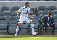 LOS ANGELES, CA - APRIL 17: Ben Sweat #22 of Austin FC moves with the ball during a game between Austin FC and Los Angeles FC at Banc of California Stadium on April 17, 2021 in Los Angeles, California.