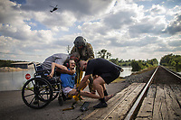 Rescue personnel help Hersey Kirk into a restraint as a rescue helicopter hovers in the distance after she was rescued from her flooded home caused by Hurricane Harvey in Rose City, Texas, U.S. on August 31, 2017.