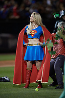 An actress portraying Superwoman during an on field performance after a Buffalo Bisons game against the Gwinnett Braves on August 19, 2017 at Coca-Cola Field in Buffalo, New York.  The Bisons wore special Superhero jerseys for Superhero Night.  Gwinnett defeated Buffalo 1-0.  (Mike Janes/Four Seam Images)