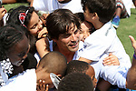 WELLINGTON, FL - MARCH 12:  Ralph Lauren model and polo player Nacho Figueras surrounded by the children of the Neil S Hirsch Boys and Girls Club of Wellington after the IPC brunch benefit for them. Scenes from the early rounds of the 26 goal USPA Gold Cup at the International Polo Club, Palm Beach on March 12, 2017 in Wellington, Florida. (Photo by Liz Lamont/Eclipse Sportswire/Getty Images)