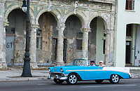 Havana, Cuba - An American car on the Malecón road facing Havana Bay. Classic American cars from the 1950s, imported before the U.S. embargo, are commonly used as taxis in Havana.