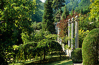 View of the colonnade in the Peto Garden at Iford Manor