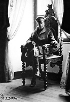 Brig. Gen. Douglas MacArthur cleaned up after the Germans left and restored what he could of the original splendor.  He is seated in the original chair of the old lord of the chateau.  St. Benoit Chateau, France.  September 19, 1918.  Lt. Ralph Estep.  (Army)<br /> NARA FILE #:  111-SC-23921<br /> WAR & CONFLICT BOOK #:  492