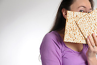 woman holding matzoh