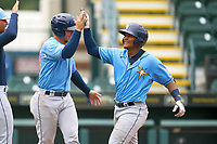 FCL Rays Mario Fernandez (59) high fives Roberto Alvarez (91) after hitting a home run during a game against the FCL Pirates Gold on July 26, 2021 at LECOM Park in Bradenton, Florida. (Mike Janes/Four Seam Images)