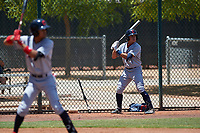 AZL Indians Red Christian Cairo (8) on deck behind Yordys Valdes (10) during an Arizona League game against the AZL Indians Blue on July 7, 2019 at the Cleveland Indians Spring Training Complex in Goodyear, Arizona. The AZL Indians Blue defeated the AZL Indians Red 5-4. (Zachary Lucy/Four Seam Images)