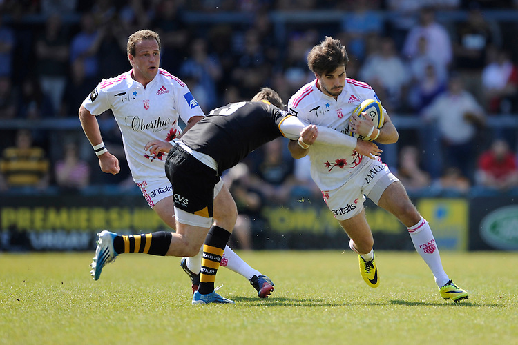 Hugo Bonneval of Stade Francais is tackled by Elliot Daly of London Wasps during the first leg of the European Rugby Champions Cup play-off match between London Wasps and Stade Francais at Adams Park on Sunday 18th May 2014 (Photo by Rob Munro)