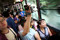 CHINA. Hong Kong. Tourists on a tram going to Victoria Peak. Officially the Hong Kong Special Administrative Region, it is a territory located on China's south coast on the Pearl River Delta. It has a population of 6.9 million people, and is one of the most densely populated areas in the world. 2008