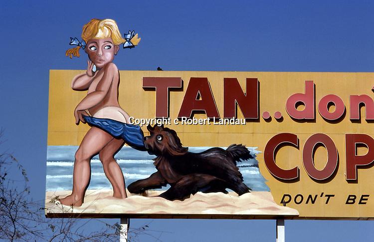 Billboard advertising Coppertone suntan lotion in Los Angeles, California