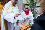 A bird is blessed by a priest at San Anton church in Madrid marking San Anton Abad's Day (Saint Anthony), on January 17, 2016. Pet animals, many dressed in their finest, trooped into churches across Spain in search of blessing on the patron saint of animals Saint Anthony's Day.  (ALTERPHOTOS/Rodrigo Jimenez)