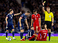 4th September 2021; Hampden Park, Glasgow, Scotland: FIFA World Cup 2022 qualification football, Scotland versus Moldova: Artur Ionita of Moldova is shown the yellow card for foul on Ryan Christie of Scotland