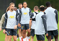 14th September 2021: The  AXA Academy, Kirkby, Knowsley, Merseyside, England: Liverpool FC training ahead of Champions League game versus AC Milan on 15th September: Jordan Henderson of Liverpool warms up with his team mates