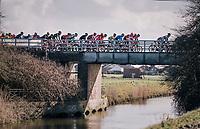 peloton bridge crossing<br /> <br /> Driedaagse Brugge-De Panne 2018<br /> Bruges - De Panne (202km)