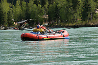 Nick Lynch and Kirsten Olsen take a rest during a slow stretch of the upper Kenai River.