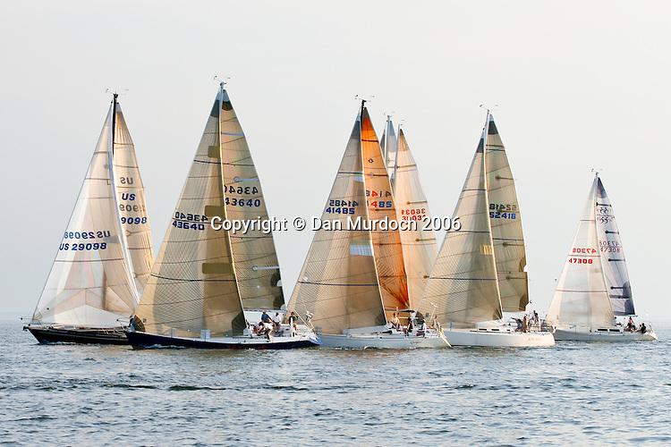 Sailboats racing at dusk
