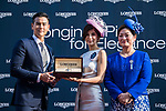 Eddie Peng, Longines Ambassador of Elegance, presents the prize to the winner of the Longines Prize for Elegances Presentation as Karen Au-Yeung (r), vice President of LONGINES Hong Kong, looks on during the Longines Hong Kong International Races at Sha Tin Racecourse on December 10 2017, in Hong Kong, Hong Kong. Photo by Victor Fraile / Power Sport Images