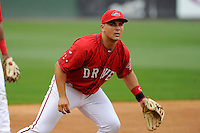 Infielder Michael Chavis (11) of the Greenville Drive, a 2014 first-round pick of the Boston Red Sox, takes ground balls at a Media Day workout on Tuesday, April 7, 2015, at Fluor Field at the West End in Greenville, South Carolina. (Tom Priddy/Four Seam Images)