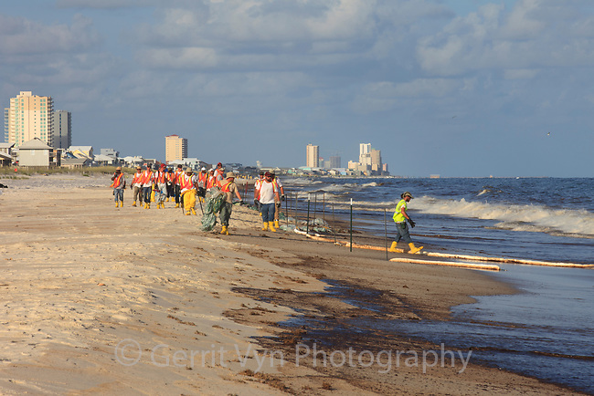 Clean up workers on the beach in response to oil comming ashore from the BP Deepwater Horizon oil leak. Baldwin County, Alabama. June 2010.