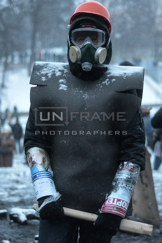 A demonstrator wears makeshift riot gear under the snow to prepare for the next clashes to  protest against new draconian law to ban protests across the country.  Kiev. Ukraine