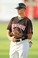 Trayce Thompson #24 of the Kannapolis Intimidators coaches first base during a South Atlantic League game against the Lakewood BlueClaws at Fieldcrest Cannon Stadium July 14, 2010, in Kannapolis, North Carolina.  Photo by Brian Westerholt / Four Seam Images
