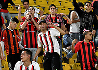 BOGOTA - COLOMBIA – 17 - 04 - 2018: Hinchas de Deportivo Lara (VEN), animan a su equipo durante partido entre Millonarios (COL) y Deportivo Lara (VEN), de la fase de grupos, grupo G, fecha 3 de la Copa Conmebol Libertadores 2018, en el estadio Nemesio Camacho El Campin, de la ciudad de Bogota. / Fans of Deportivo Lara (VEN), cheer for their team during a match between Millonarios (COL) and Deportivo Lara (VEN), of the group stage, group G, 3rd date for the Conmebol Copa Libertadores 2018 in the Nemesio Camacho El Campin stadium in Bogota city. VizzorImage / Luis Ramirez / Staff.