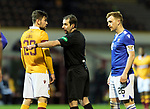 Motherwell v St Johnstone…28.11.20   Fir Park      BetFred Cup<br />Referee Alan Muir has words with Callum Lang and Liam Craig<br />Picture by Graeme Hart.<br />Copyright Perthshire Picture Agency<br />Tel: 01738 623350  Mobile: 07990 594431
