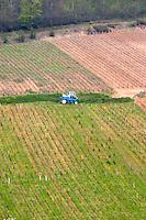 tractor in the vineyard pernand-vergelesses cote de beaune burgundy france
