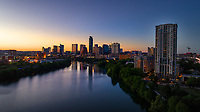 Austin, Texas is the fastest growing downtown Skyline in Texas and greatest commercial and residential real estate market boom in Texas. In this photo of the downtown skyscrapers nestle around Lady Bird Lake.