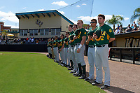Siena Saints players stand for the national anthem before a game against the UCF Knights on February 21, 2016 at Jay Bergman Field in Orlando, Florida.  UCF defeated Siena 11-2.  (Mike Janes/Four Seam Images)