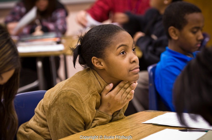 Students at Meany Middle School work with Daemond Arrindell , a poet from Seattle's Writers in the Schools.