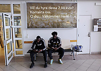 Wednesday 07 August 2013<br /> Pictured L-R: Roland Lamah and team mate Wilfried Bony check message on their phones after landing at Malmo Airport<br /> Re: Swansea City FC travelling to Sweden for their Europa League 3rd Qualifying Round, Second Leg game against Malmo.