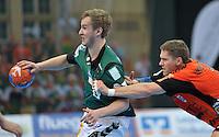 Handball 2. Bundesliga Herren - SC DHfK gegen HC Erlangen am 05.11.2013 in Leipzig (Sachsen). <br /> IM BILD: Alexander Feld (DHfK) am Ball gegen Sebastian Preiß / Preiss <br /> Foto: Christian Nitsche