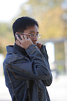 Students on mobile phones at the University of Surrey.
