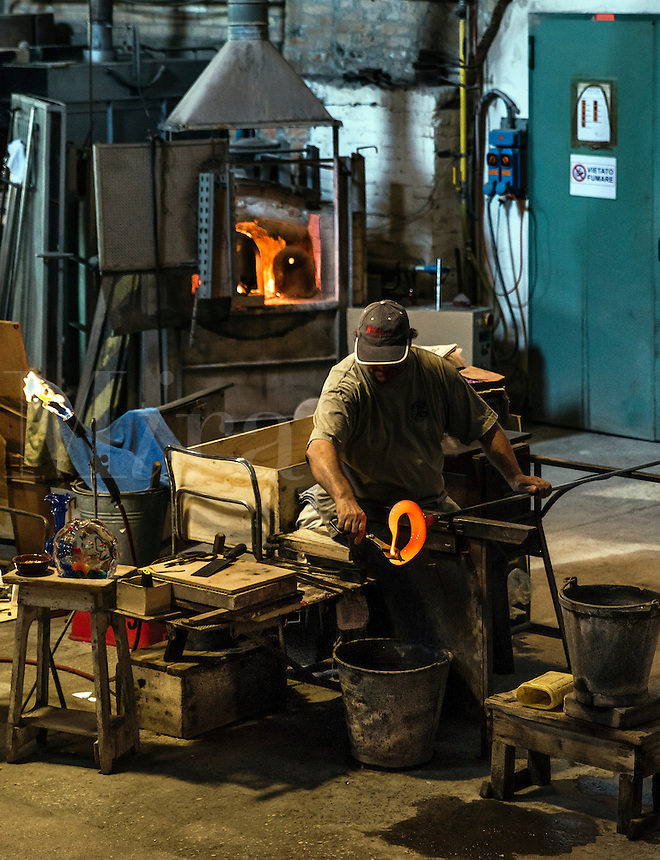 Glassmith working, Venitian island of Murano, Italy. Famous for it's many furnaces and hand made glass.