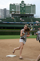 August 9, 2009:  Iowa Cubs fan takes a picture of herself as she runs the bases after a game at Wrigley Field in Chicago, IL.  Iowa is the Pacific Coast League Triple-A affiliate of the Chicago Cubs.  Photo By Mike Janes/Four Seam Images