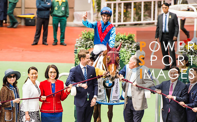 Jockey Joao Moreira riding Rapper Dragon celebrates winning the 2017 BMW Hong Kong Derby Race with the trainer John Moore and the horse owner Albert Hung Chao-hong at the Sha Tin Racecourse on 19 March 2017 in Hong Kong, China. Photo by Marcio Rodrigo Machado / Power Sport Images